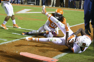 UVA's Maurice Canady looks on as an SU player falls out of bounds with the ball.