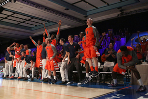 Syracuse's bench celebrates during the Battle 4 Atlantis tournament. SU won three games in three days.