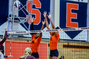 Jalissa Trotter (14) was a bright spot for Syracuse's struggling team. She had the second most blocks on the team and the second highest hitting percentage.