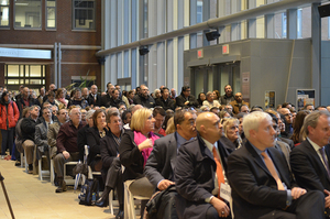 Syracuse University community members listen to Chancellor Kent Syverud's address inside Milton Atrium at the Life Sciences Complex.