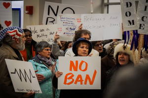 Hundreds protested Trump's travel and refugee ban Sunday night at Syracuse Hancock International Airport.