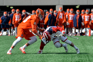 The Orange's Peter Dearth tries to take the ball from a tripped up SJU player.