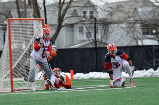 A Syracuse player dives in front of Costa.