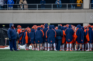 Syracuse huddles up on the sideline.
